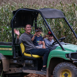 The charismatic William driving Anni and his brother around the farm